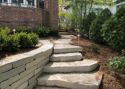 Retaining Wall with Stone Stairs in Residential Setting